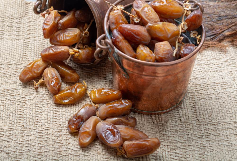 Tunisia - Tunisian Food - Authentic Tunisian Deglet Nour dried dates with soft honey-like taste in copper buckets