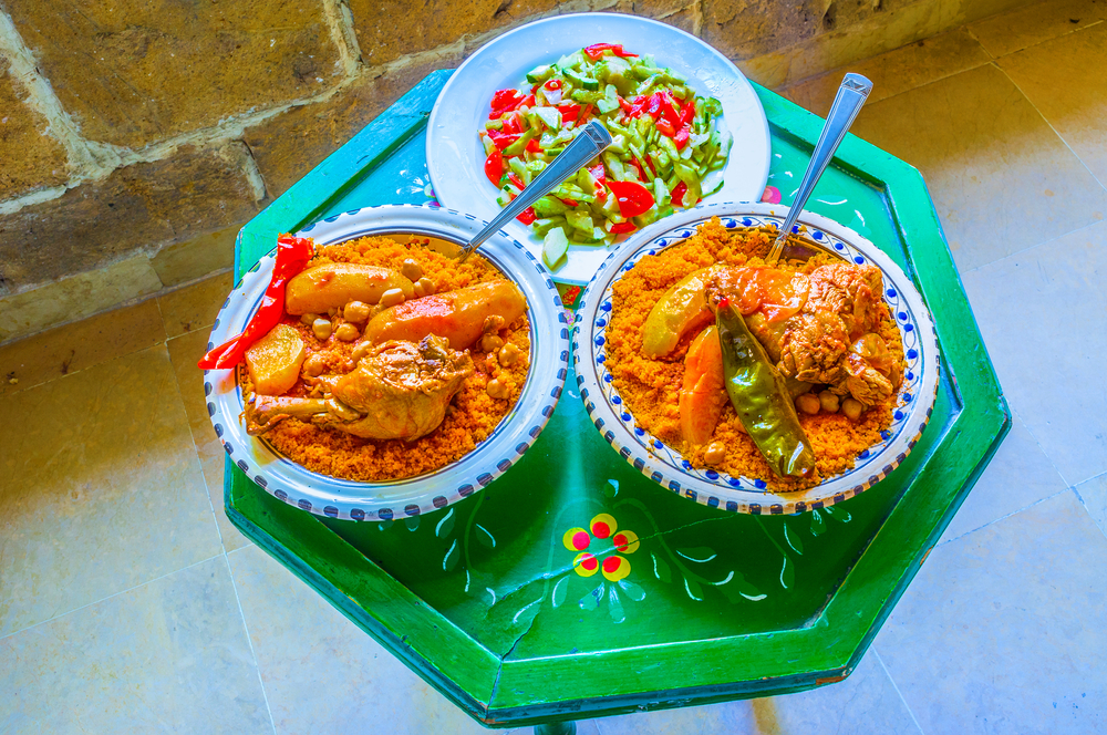 Tunisia - Tunisian Food - The traditional Tunisian dinner includes vegetable salad and couscous with chicken, Sousse, Tunisia. - Image