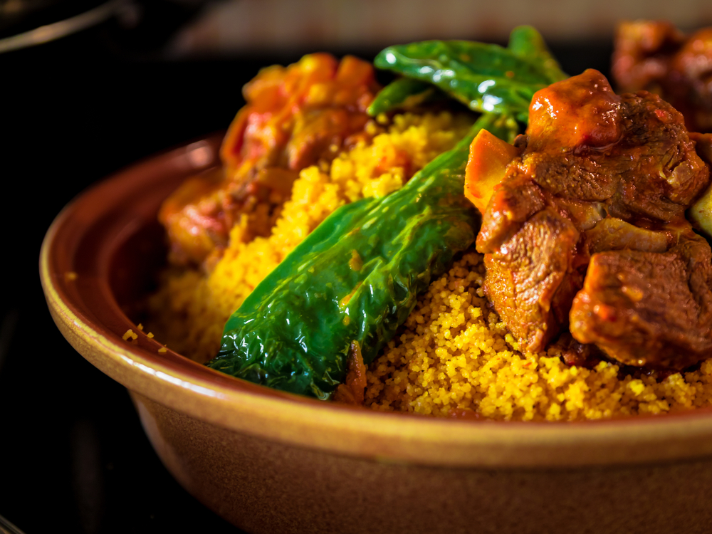 Tunisia - Tunisian Food - couscous meal with green pepper and meat in a traditional Arabic plate